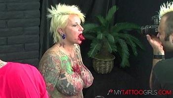 Heavy Tattooed Model BlackWidowXXX Getting Her Tongue Split