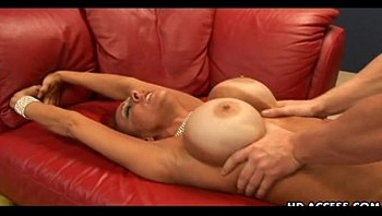 Mature redhead Whitney Wonders shows off her big tits