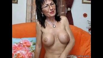 Busty mature masturbates on webcam