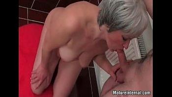 Old mature slut sucks some young cock