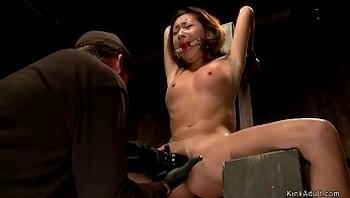 Petite Asian in bdsm throne fingered