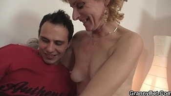 Skinny blonde granny spreads her legs