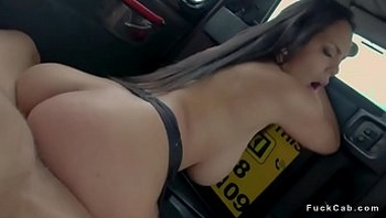 Curved brunette fucks in fake taxi
