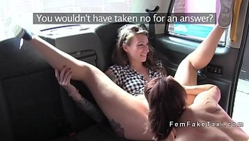 Lesbian masturbates with toy in fake cab