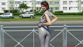 Sexy Natalia walks down the street in tight leggings