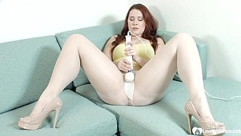 Redhead in white pantyhose uses a Hitachi