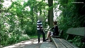 Man stalks a woman in a park