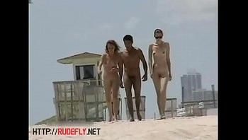 Busty nude beach babes filmed by a voyeur