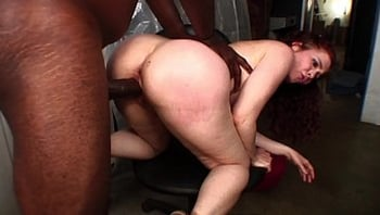 Horny red head with big ass Mae Victoria was fucking with black cock in store room