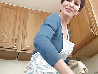 Mommy teasing in the kitchen...