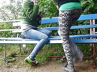 Two cute 18 years friends piss together in a park
