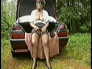 Granny in stockings crammed in the nature