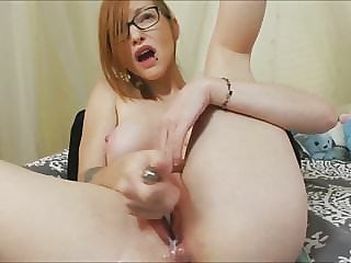 Cutie with glasses bates and creams her pussy