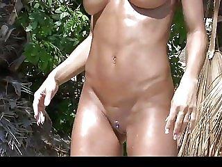 Hot fit milf posing in tiny bikini on the beach