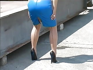 Walking in blue Leather skirt and high heels