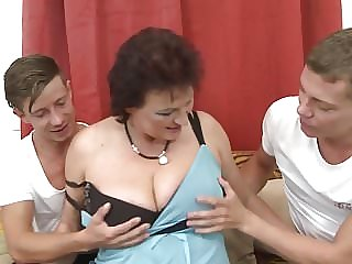 Young sons sharing mature bigtit mother
