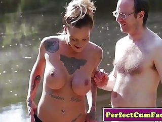 Busty femdom tugging guy outdoors for spunk