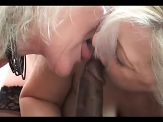 2 concupiscent grannies share a large dark dong