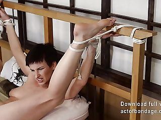 Claudia tied to the bedpost