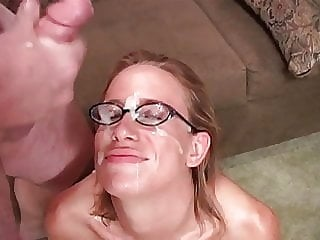 blonde sucks cocks and gets cum on her face and glasses