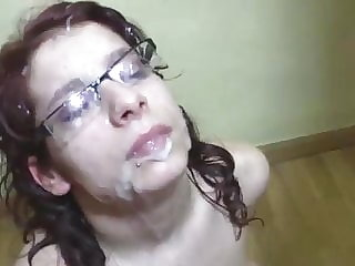 Busty redhead with glasses receives a cumbath