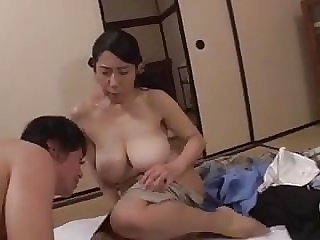 Son gets horny watching mom. She helps him.