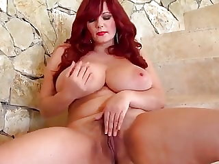 busty redhead  shows us her big naturals and hairy pussy