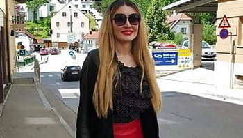 Sexy Blond Lady with Tight Red Leather Skirt and High- Boots