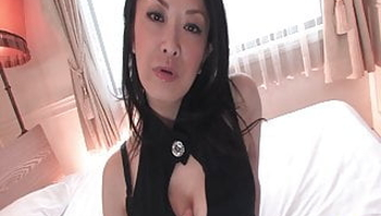 Beautiful Japanese MILF with big boobs fingers herself