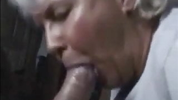 Grandma works cock head with lips and gets cum
