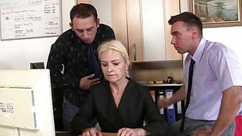 Sexy blonde grandma swallows two cocks for work