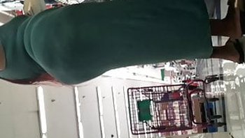 Thick tatted ebony MILF flaunts big ass in green dress. Prt2
