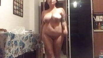 Turkish milf walks naked in the kitchen