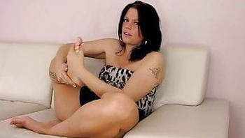 German Brunette Licks her Feet on Couch