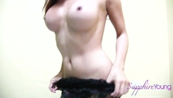 Big cock Trans Sapphire plays with her dildo