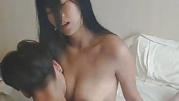 Wild asian milf rides a young boy