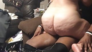 White wife on couch riding young black bull