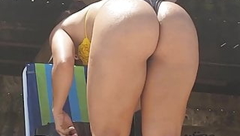 Candid perfect big butt brunette MILF in tiny bikini