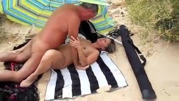 Amateur Couple on Beach with Stranger